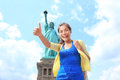 New york city statue of liberty tourist woman giving thumbs up happy girl on tourism travel on island usa young Stock Image