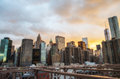 New york city terrific sunset view from brooklyn bridge with sk skyscrapers in summer season Royalty Free Stock Photography