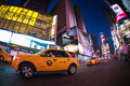 New york city times square in manhattan with all the lit up billboards and advertisements Stock Photos