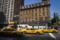 New york city united states september new york city yellow cabs taxi top adverts wait traffic lights th th manhattan Stock Image
