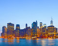 New york city usa lights on the buildings in lower manhattan are reflected water during colorful sunset Stock Photo