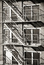 Exterior of a building with old fire escape in  New York City Royalty Free Stock Photo
