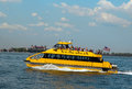 New york city water taxi in the front of ellis island august on august nyc has been servicing nyc commuters Royalty Free Stock Photography