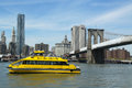 New york city water taxi with nyc skyline and brooklyn bridge seen from brooklyn bridge park april on april Stock Images