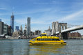 New york city water taxi with nyc skyline and brooklyn bridge seen from brooklyn bridge park april on april Royalty Free Stock Photos