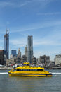 New york city water taxi with nyc skyline seen from brooklyn bridge park april on april has been servicing Stock Image
