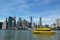 New york city water taxi with nyc skyline seen from brooklyn bridge park april on april has been servicing Stock Photography