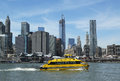 New york city water taxi with nyc skyline seen from brooklyn bridge park april on april has been servicing Royalty Free Stock Image