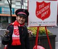 Salvation Army soldier performs for collections in midtown Manhattan Royalty Free Stock Photo