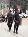 Salvation Army soldiers perform for collections in midtown Manhattan during holidays season Royalty Free Stock Photo
