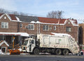 New York Department of Sanitation truck cleaning streets in Brooklyn after massive winter storms Royalty Free Stock Photo