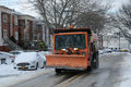 New York Department of Sanitation truck cleaning streets in Brooklyn, NY after massive Winter Storm Helen