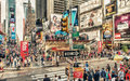 New york may tourists walk in busy times square intersecti intersection city is the most visited tourist Royalty Free Stock Photo