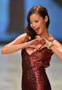 NEW YORK, NY - FEBRUARY 06: Jamie Chung wearing David Meister walks the runway at The Heart Truth's Red Dress Collection during Fa Royalty Free Stock Photos