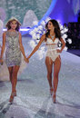 New york ny november singer taylor swift performs l and model lily aldridge walks the runway at victoria s secret fashion show Royalty Free Stock Image