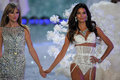 New york ny november singer taylor swift performs l and model lily aldridge walks the runway at victoria s secret fashion show Royalty Free Stock Photography