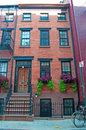 New York: red townhouses in Greenwich Village on September 15, 2014 Royalty Free Stock Photo