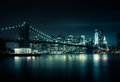 New york skyline by night with a reflection on the river Stock Images