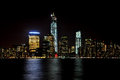 New york skyline at night skyscrapper with reflection in the water Stock Photography
