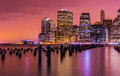 New York skyline at night with varicolored reflections in the water, USA Royalty Free Stock Photo