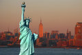 New york the statue of liberty an american symbol with lower manhattan skyline at sunset in background tourism concept photo Stock Image