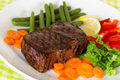 New York Steak- meat on Green Beans,Carrot,Pepper Stock Photos