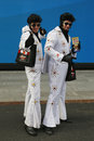 Only in New York. Unidentified street performers dressed as Elvis Presley at Times Square in Midtown Manhattan Royalty Free Stock Photo