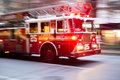New york us november motion blurred shot of famous new yo fire engine with lights flashing in Royalty Free Stock Images