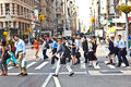 New york usa – july people at a pedestrian crossing in downtown manhattan hurry to their offices early morning on Stock Images