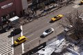 New york usa november th high angle view of yellow taxis cars and pedestrians in greenwich street next to christopher street in Royalty Free Stock Photo