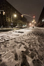 New york usa november th the intersection of manhattan avenue and nd street in harlem covered with snow at a cold early winter Royalty Free Stock Photography