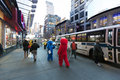New york usa november th two actors hidden in elmo and cookie monster costumes amuse the pedestrian walking by at nd street just Stock Photos