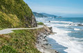 New zealand coastal highway a scenic road winds along the western shore of zealand's south island Stock Photo