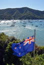 New zealand flag proudly fluttering in marlborough sounds on a spring day Stock Photo