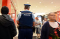New Zealand police officers patrol in a mall in Auckland Royalty Free Stock Photo