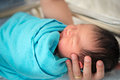 Newborn asian baby girl in hospital father holding inside room Stock Photo