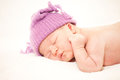 Newborn baby age days sleeps knitted hat Royalty Free Stock Photos