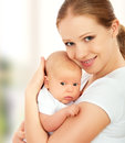 Newborn baby in the arms of mother little Stock Images