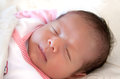 Newborn baby asleep sleeping on a white blanket Royalty Free Stock Photography