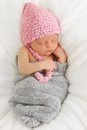 Newborn baby asleep wearing a knitted hat Royalty Free Stock Photography