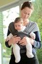 Newborn Baby In A Baby Sling W...