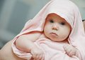 Newborn baby after bathe girl portrait in cover Stock Photography