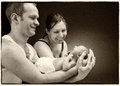 Newborn baby boy on the father's and mother's hand Royalty Free Stock Photo