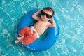 Newborn Baby Boy Floating on an Inner Tube Royalty Free Stock Photo