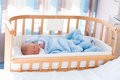 Newborn baby boy in hospital cot Royalty Free Stock Photo
