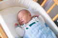 Newborn baby boy in hosptal cot Royalty Free Stock Photo