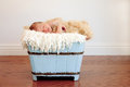 image photo : Newborn baby boy in light blue wood container