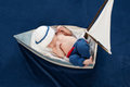 Newborn Baby Boy Sailor Sleeping in a Boat Royalty Free Stock Photo