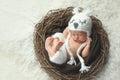 Newborn Baby Boy Wearing a White Owl Hat Royalty Free Stock Photo