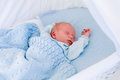 Newborn baby boy in white bassinet Royalty Free Stock Photo